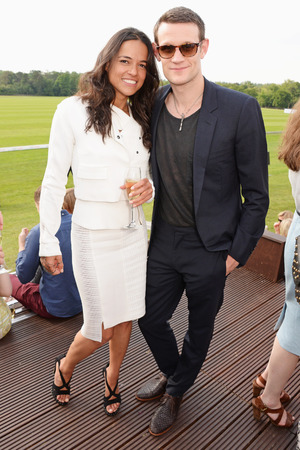 ASCOT, ENGLAND - JUNE 01: Michelle Rodriguez (L) and Matt Smith attend day two of the Audi Polo Challenge at Coworth Park Polo Club on June 1, 2014 in Ascot, England. (Photo by David M. Benett/Getty Images for Audi)