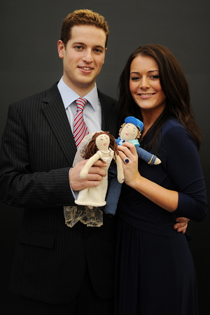 Kate Middleton and Prince William lookalikes aka Kate Bevan (R) and Andy Walker (L) pose for photographers with hand knitted figures depicting Prince William and Kate Middleton on their wedding day during the UK toy annual trade show in central London, on January 25, 2011. Prince William, the second in line to the throne, and Kate Middleton announced their engagement in November after a seven-year romance that began at university. The wedding, at Westminster Abbey on April 29 in London, is set to be Britain's biggest royal wedding since William's parents, Prince Charles and Lady Diana Spencer, married in 1981. April 29 has been made a public holiday throughout the kingdom. AFP PHOTO/Ben Stansall (Photo credit should read BEN STANSALL/AFP/Getty Images)