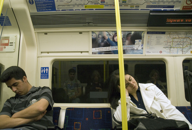 Commuters asleep on the tube