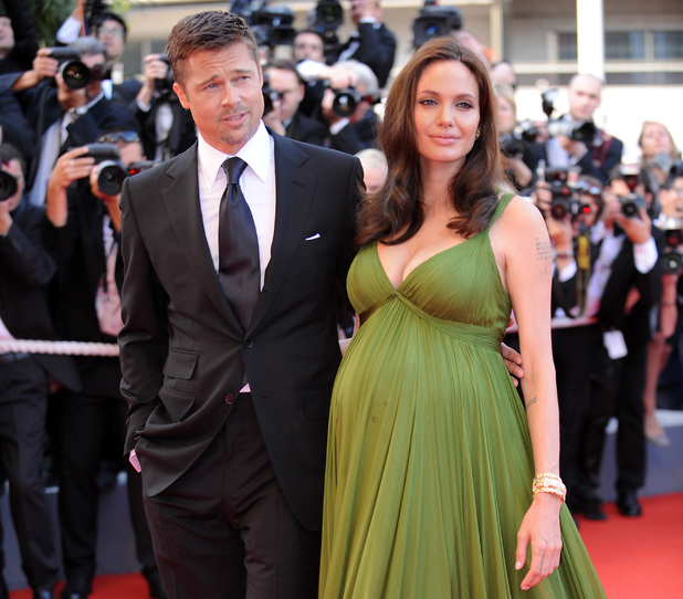 US actors Angelina Jolie (R) and Brad Pi Caption:US actors Angelina Jolie (R) and Brad Pitt arrive to attend the screening of US directors John Stevenson and Mark Osborne's film 'Kung Fu Panda' at the 61st Cannes International Film Festival in Cannes, southern France, on May 15, 2008. The Cannes film festival on May 14, 2008 officially unrolled its red carpet with a star-studded ceremony kicking off the 12-day frenzy of movies, parties and deals. AFP PHOTO / Anne-Christine Poujoulat (Photo credit should read ANNE-CHRISTINE POUJOULAT/AFP/Getty Images)