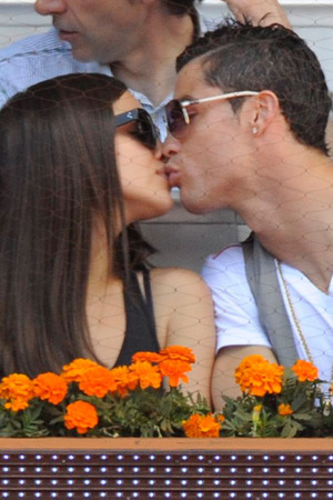 MADRID, MADRID - MAY 12: Irina Shayk and Cristiano Ronaldo share a kiss as they attend the Mutua Madrid Open tennis tournament at La Caja Magica on May 12, 2013 in Madrid, Spain. (Photo by Europa Press/Europa Press via Getty Images)