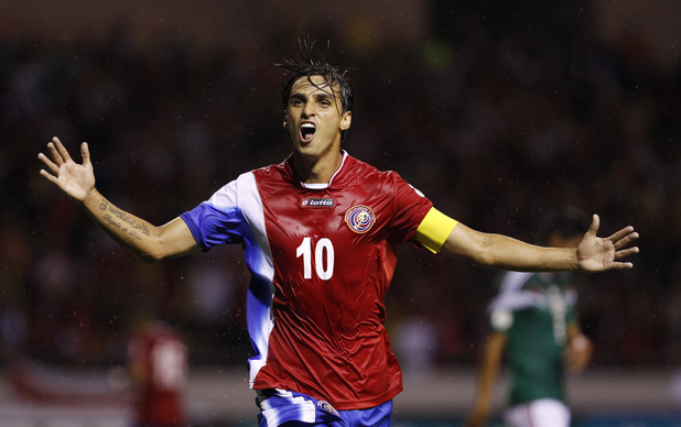 Costa Rica's Bryan Ruiz celebrates scoring his side's first goal during a 2014 World Cup qualifying soccer match in San Jose, Costa Rica, Tuesday, Oct. 15, 2013. (AP Photo/Fernando Vergara)