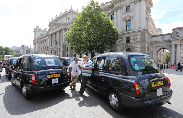 Taxi drivers protest on The Mall in London over the Uber smartphone application