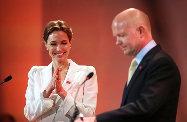 LONDON, ENGLAND - JUNE 10: UN Special Envoy and actress Angelina Jolie (L) applauds as British Foreign Secretary William Hague speaks at the Global Summit To End Sexual Violence In Conflict on June 10, 2014 in London, England. The four-day conference on sexual violence in war is hosted by Foreign Secretary William Hague and UN Special Envoy and actress Angelina Jolie. (Photo by Peter Macdiarmid/Getty Images)