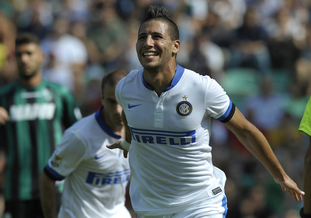 Inter Milan's Saphir Taider, of Algeria, celebrates after scoring a goal during their Serie A soccer match against Sassuolo, at Reggio Emilia's Mapei stadium, Italy, Sunday, Sept. 22, 2013. (AP Photo/Marco Vasini)