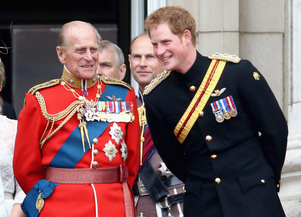Prince Harry and Prince Philip, Duke of Edinburgh share a joke on the balcony during Trooping the Colour