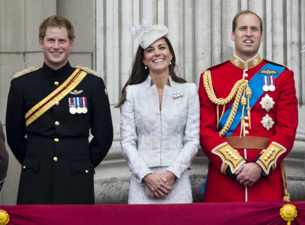Prince Harry, Catherine, Duchess of Cambridge and Prince William, Duke of Cambridge on the balcony during Trooping the Colour