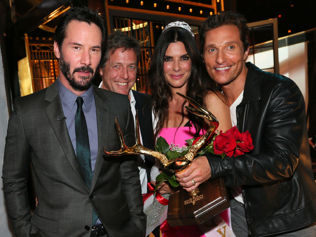 LOS ANGELES, CA - JUNE 07: Matthew McConaughey, Keanu Reeves, Hugh Grant, and winner of the Decade of Hotness award Sandra Bullock speak onstage during Spike TV's 'Guys Choice' Awards held at Sony Studios on June 7, 2014 in Los Angeles, California. (Photo by Michael Tran/FilmMagic)