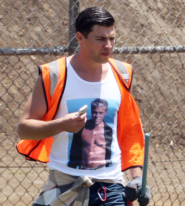 Vitalii Sediuk performs community service while wearing a t-shirt with Brad Pitt on