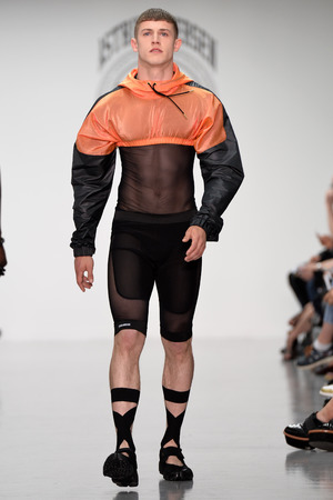 LONDON, ENGLAND - JUNE 15: A model walks the runway at the Astrid Andersen show during the London Collections: Men SS15 on June 15, 2014 in London, England. (Photo by Victor VIRGILE/Gamma-Rapho via Getty Images)