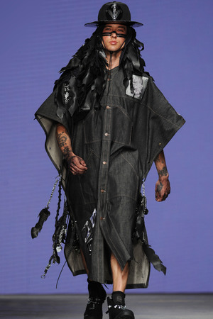 LONDON, ENGLAND - JUNE 15: A model walks the runway wearing designs by Liam Hodges, part of the MAN show during the London Collections: Men SS15 at The Old Sorting Office on June 15, 2014 in London, England. (Photo by Stuart C. Wilson/Getty Images)