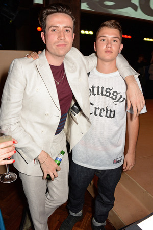 LONDON, ENGLAND - JUNE 15: Nick Grimshaw (L) and Rafferty Law attend the Esquire & DKNY MEN official opening night party for London Collections: Men at one Embankment on June 15, 2014 in London, England. (Photo by David M. Benett/Getty Images for DKNY)