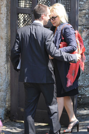 Jennifer Saunders arrives for the funeral of Rik Mayall at St George's church in Dittisham