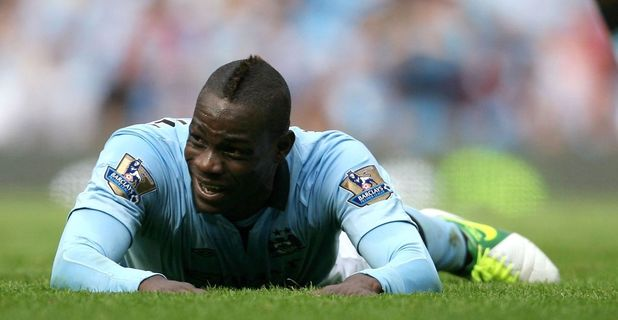 Manchester City v Sunderland, Barclays Premier League football match, Manchester, Britain - 06 Oct 2012 Mario Balotelli of Man City lies on the floor laughing and smiling 6 Oct 2012