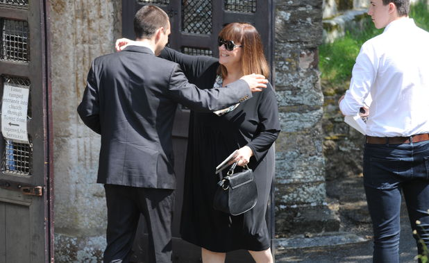 Dawn French arrives for the funeral of Rik Mayall at St George's church in Dittisham