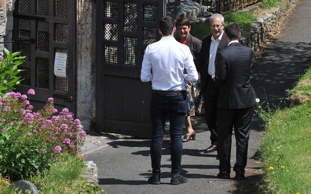 Ben Elton arrives for the funeral of Rik Mayall at St George's church in Dittisham