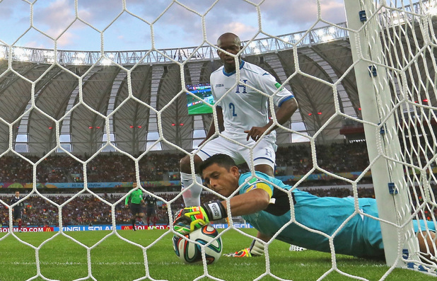 Honduras goalkeeper Noel Valladares fumbles the ball over the line during the 2014 World Cup match between France and Honduras
