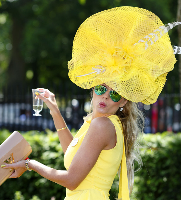 ASCOT, UNITED KINGDOM - JUNE 17: (EMBARGOED FOR PUBLICATION IN UK NEWSPAPERS UNTIL 48 HOURS AFTER CREATE DATE AND TIME) A racegoer attends Day 1 of Royal Ascot at Ascot Racecourse on June 17, 2014 in Ascot, England. (Photo by Max Mumby/Indigo/Getty Images)