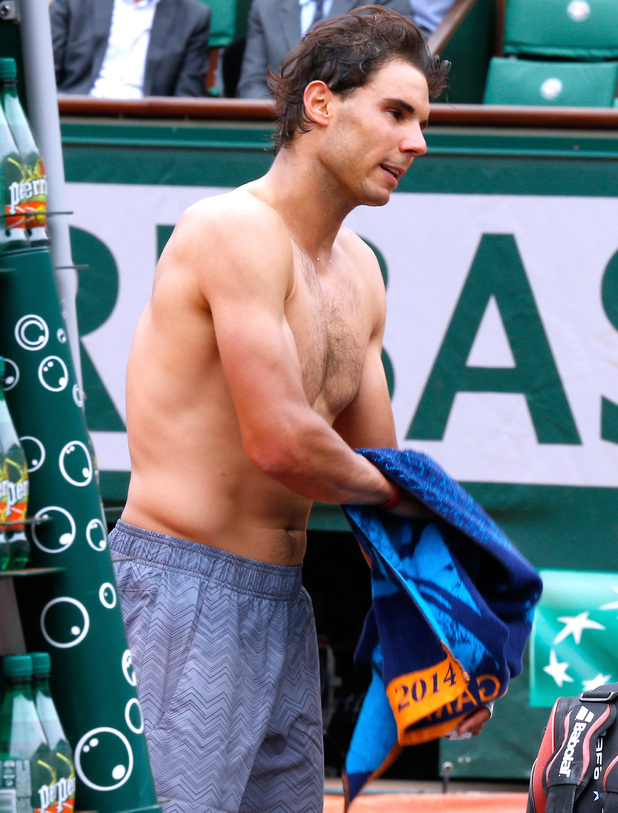 Caption:PARIS, FRANCE - JUNE 02: Tennis player Rafael Nadal changes clothes at the end of his match at the Roland Garros French Tennis Open 2014 - Day 9 on June 2, 2014 in Paris, France. (Photo by Rindoff/Charriau/French Select/Getty Images