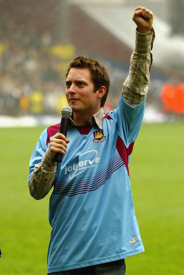 LONDON - MAY 1: Actor Elijah Wood is seen during the half time of the West Ham v Watford Match at The Boleyn Ground, Upton Park on May 1, 2004 in London. The scene forms part of Wood's new film 'The Yank', a London-set tale of football thugs. (Photo by Bruno Vincent/Getty Images)