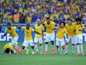 Brazil celebrate after winning the penalty shoot-out during the 2014 FIFA World Cup Brazil Round of 16 match between Brazil and Chile