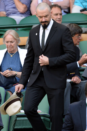 LONDON, ENGLAND - JUNE 24: Hugh Jackman attends the Julia Glushko v Sabine Lisicki match on centre court during day two of the Wimbledon Championships at Wimbledon on June 24, 2014 in London, England. (Photo by Karwai Tang/WireImage)