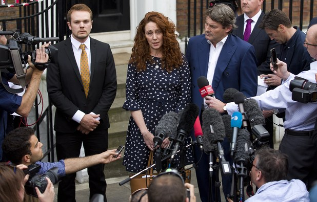 Rebekah Brooks and her husband Charlie Brooks give a statement to members of the media