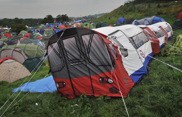 A tent in the shape of a London Underground Northern Line carriage is pitched at Glastonbury