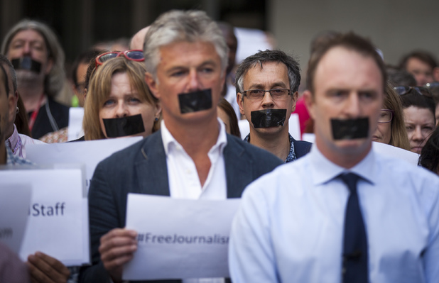 BBC staff and colleagues from other news organisations take part in a one-minute silent protest outside New Broadcasting House against the seven-year jail terms given to three Al-Jazeera journalists in Egypt