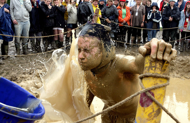 Men compete in a mud wrestling contest at the 2007 Glastonbury Festival at Worthy Farm in Pilton, Somerset. Picture date: Sunday June 24, 2007. The festival has been going 27 years and is now the largest music festival in Europe. Photo credit should read: Anthony Devlin/PA