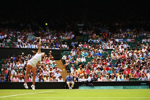 Julia Glushko of serves during her Ladies' Singles first round match against against Sabine Lisicki