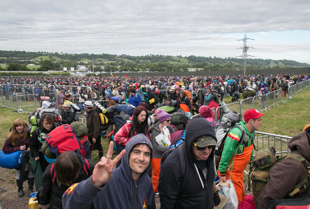 Festival-goers arrive at Worthy Farm for the first day of Glastonbury 2014.