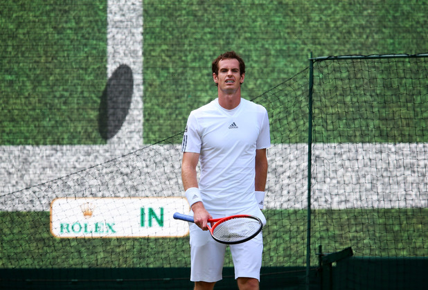 Wimbledon 2013: Andy Murray of Great Britain reacts to a decision from Hawk-Eye