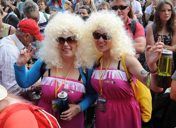 Dolly Parton fans wave in the crowd on the final day of Glastonbury Festival