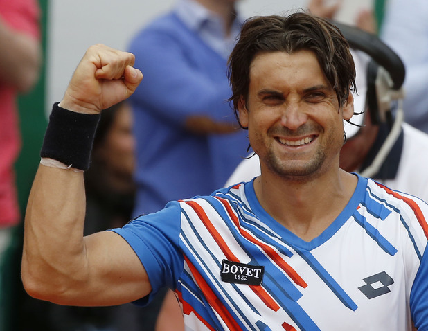 David Ferrer of Spain, celebrates after defeating Rafael Nadal of Spain during their quarterfinals match of the Monte Carlo Tennis Masters tournament in Monaco, Friday, April 18, 2014. Ferrer won 7-6 6-4. (AP Photo/Michel Euler)