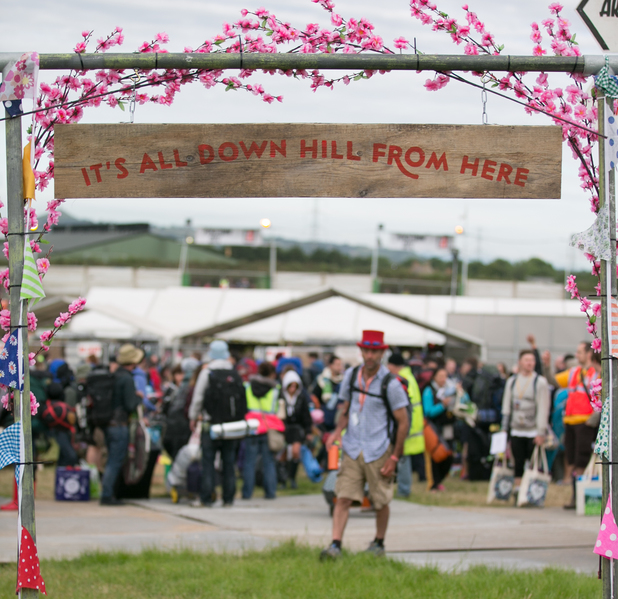 'It's All Down Hill From Here' sign at Glastonbury 2014.