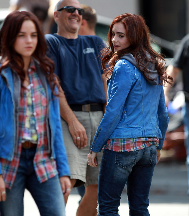 Headline: Lily Collins looks at her stunt double on set of 'The Mortal Instruments: City of Bones' filming in Toronto Date of Picture: 08/21/2012 See the set: SPL428277 Usage: World Rights Caption: Lily Collins looks at her stunt double on set of 'The Mortal Instruments: City of Bones' filming in Toronto.