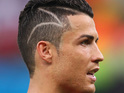 The Portugal striker debuted his new haircut during World Cup game against USA.