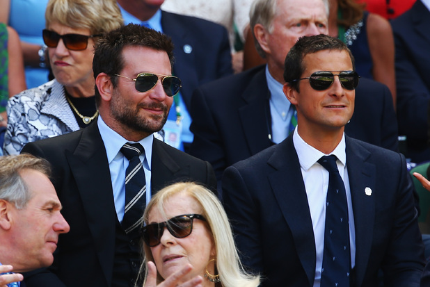 Caption:LONDON, ENGLAND - JULY 04: Bradley Cooper and Bear Grylls in the royal box for the Gentlemen's Singles semi-final match between Novak Djokovic of Serbia and Grigor Dimitrov of Bulgaria on day eleven of the Wimbledon Lawn Tennis Championships at the All England Lawn Tennis and Croquet Club on July 4, 2014 in London, England. (Photo by Clive Brunskill/Getty Images)