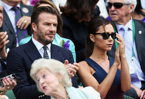 David Beckham and Victoria Beckham attend the mens singles final between Novak Djokovic and Roger Federer on centre court