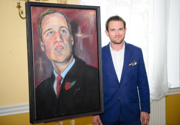 British artist Dan Llywelyn Hall poses for a photograph following the unveiling of the new portrait of the Duke of Cambridge, at the Welsh Office in central London on July 2, 2014. The oil painting is titled 'Fatherhood' and will be auctioned on October 1, 2014, with all proceeds going to The Victoria Cross Trust and War Memorials Trust. AFP PHOTO / LEON NEAL RESTRICTED TO EDITORIAL USE, MANDATORY MENTION OF THE ARTIST UPON PUBLICATION, TO ILLUSTRATE THE EVENT AS SPECIFIED IN THE CAPTION (Photo credit should read LEON NEAL/AFP/Getty Images)