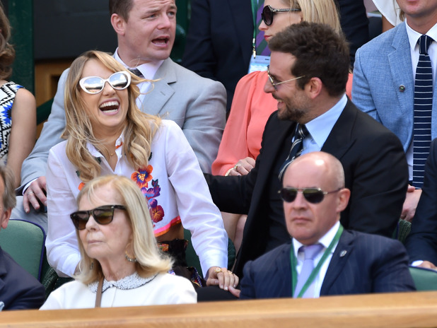 Caption:LONDON, ENGLAND - JULY 04: Suki Waterhouse and Bradley Cooper attend the semi-final match between Noval Djokovic and Grigor Dimitrov on centre court at The Wimbledon Championships at Wimbledon on July 4, 2014 in London, England. (Photo by Karwai Tang/WireImage)