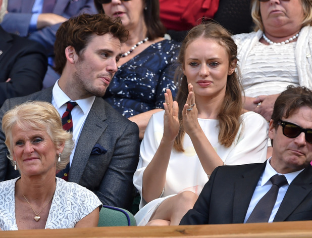 Caption:LONDON, ENGLAND - JULY 03: Sam Claflin and Laura Haddock attend the quarter final match beteween Lucie Safarova v Petra Kvitova on centre court during day ten of the Wimbledon Championships at Wimbledon on July 3, 2014 in London, England. (Photo by Karwai Tang/WireImage)