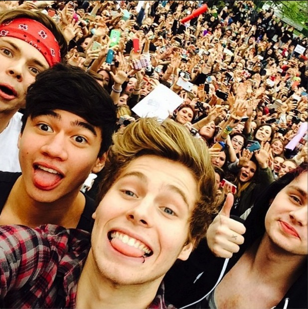 5 Seconds of Summer take selfie with fans
