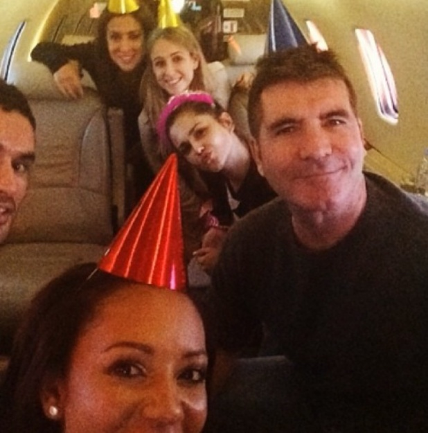 Simon Cowell in a party hat: X Factor judges mark Cheryl Cole's birthday