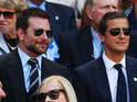 Gerard Butler's nowhere in sight as Cooper enjoys the tennis with Bear Grylls.