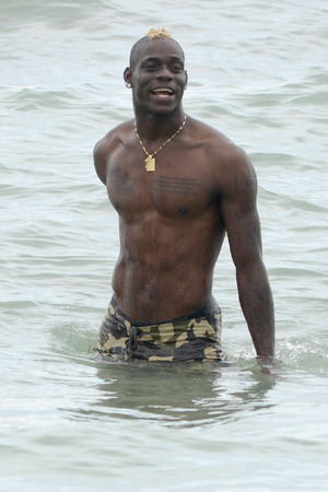 MIAMI, FL - JULY 06: Mario Balotelli is seen on the beach in Miami Beach on July 6, 2014 in Miami, Florida. (Photo by Dave Lee/GC Images)