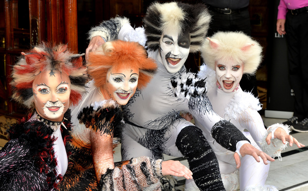Cast Members pose during a photocall for 'Cats' at London Palladium