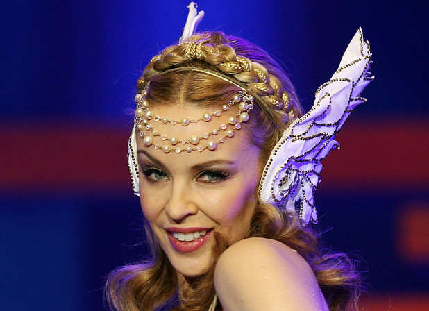Kylie Minogue Live In Sydney Caption:SYDNEY, AUSTRALIA - JUNE 07: Kylie Minogue performs live on stage during her Aphrodite Les Folies tour at Sydney Entertainment Centre on June 7, 2011 in Sydney, Australia. (Photo by Mark Metcalfe/Getty Images)