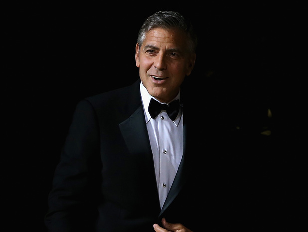 SHANGHAI, CHINA - MAY 16: Actor George Clooney arrives for the red carpet of Omega Le Jardin Secret dinner party on May 16, 2014 in Shanghai, China. (Photo by Feng Li/Getty Images)